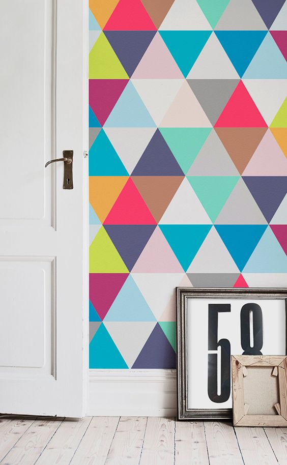 Ready for a home filled with colour and joy? This geometric wallpaper design will embellish your walls with vibrant colours and funky patterns. It'll look great in hallway spaces!