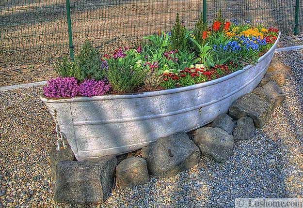 22 Landscaping Ideas to Reuse and Recycle Old Boats for Yard Decorations.  Going to try this out by a big boulder in my yard  Will remove the windshield though!