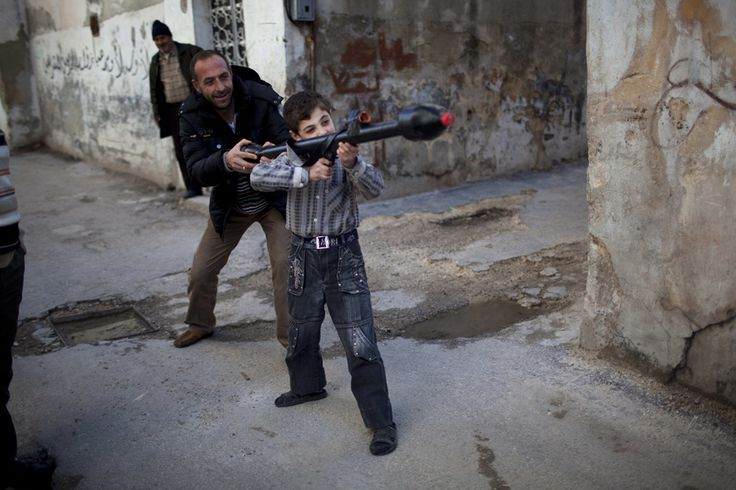Pulitzer Prize Winning Photography   Rodrigo Abd Pulitzer-winning photo: A man teaches Bilal, 11, how to ...