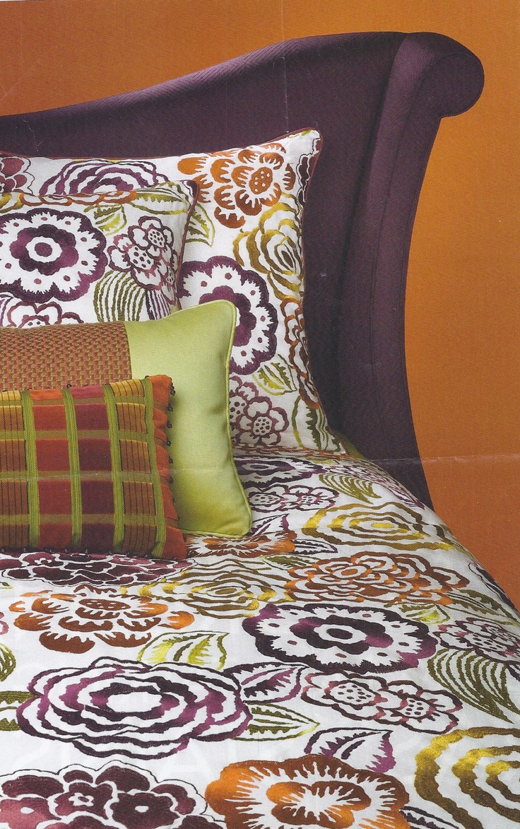 purple green orange bedroom. not too sure about the pillow in the front, but I love the headboard and bedspread!