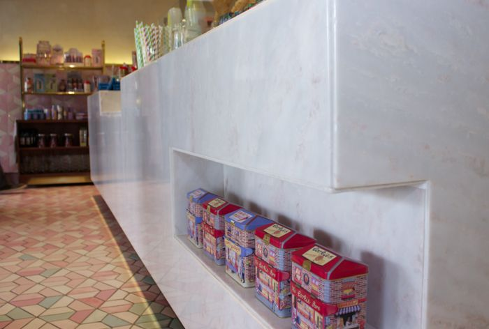 An interesting recessed shelf in the marble block bar at tashas waffle house Constantia Village, Cape Town. We love the marble pairing with the pink and blue floor tiles.  Get your marble slabs at www.rudischoice.co.za