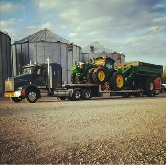 Kenworth custom T800 with a John Deere Tractor on wagon