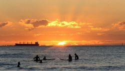 TWA-0051387 © WestPix Sunset surfers at Freo beach. Picture by Sharon Smith The…