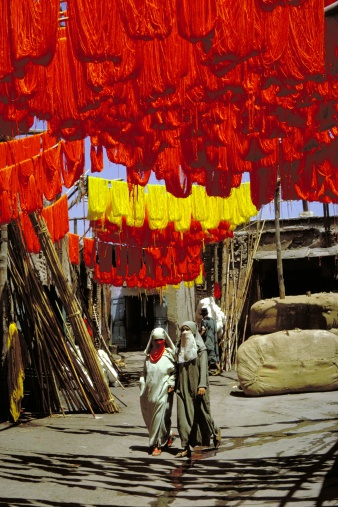 Dyed wool for carpets drying in a souk (bazaar). Marrakech, Morocco.