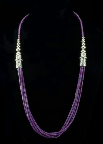 "Purple Turquoise Heshi Necklace  Five strands of genuine Turquoise dyed to a beautiful purple color. Hand made sterling silver barrel beads and round beads with southwestern design. Necklace is 25"""" and signed by the Native American artist.   http://www.sterlingjewelrystores.com/sterling-silver-Purple-Turquoise-Heshi-Necklace.html"