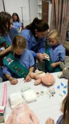 Girl Scouts earn Junior First Aid Badge at TRMC Teddy Bear Clinic