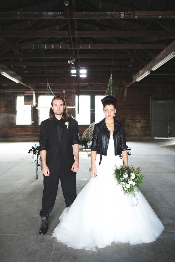 Leather jacket cover up for the bride. And I love how the groom has his sleeves rolled up! They both look awesome