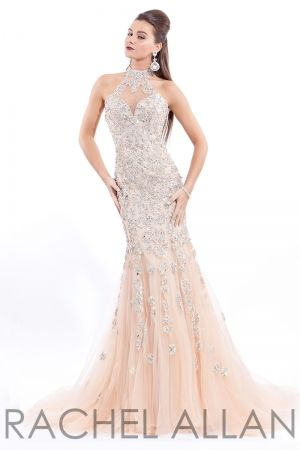 Hand beaded soft tulle/lace gown. Key hole back.Order today by calling Everything for Pageants at 1-815-782-8877 and ask for our current promotions.