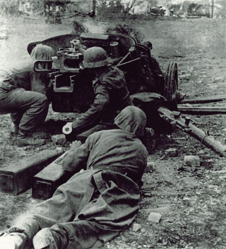 The crew of a 5cm PaK38 , work to set their gun up for action in outskirts of Stalingrad . Sep 1942