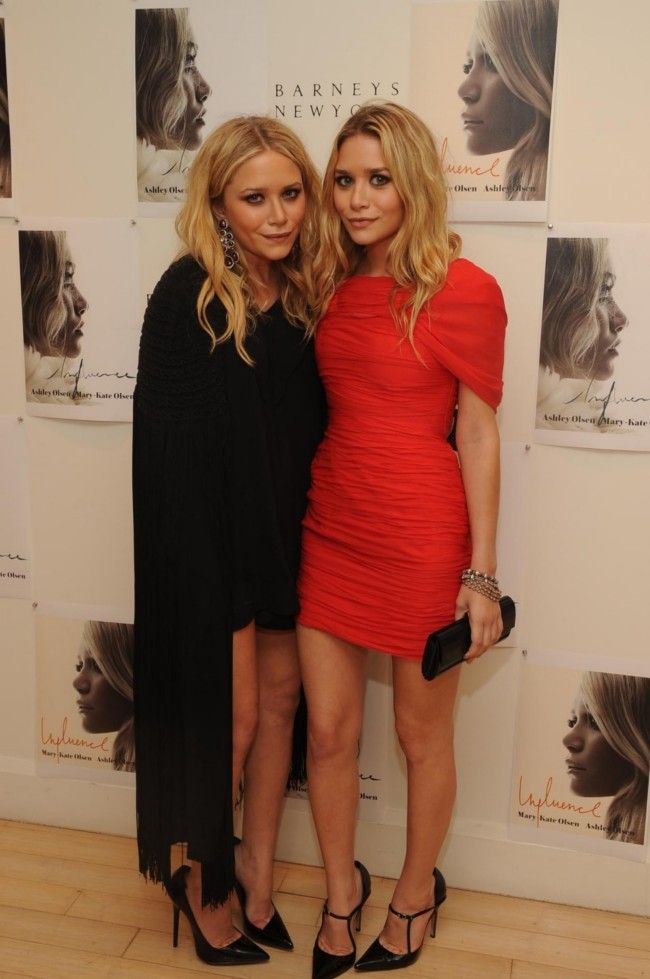 Mary-Kate and Ashley Olsen attend the Mary-Kate & Ashley Olsen Book Party at Barney's in New York City.