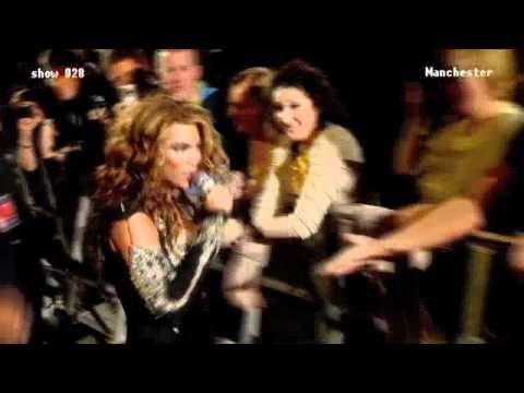 Beyonce hands the microphone to one of her audience