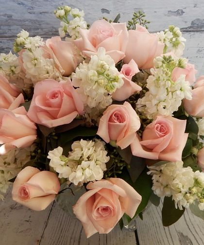 Miss Patti-Soft and graceful pink roses with sweet-scented stock flowers and a bit of added sparkle are presented in a bubble bowl glass vase to mark an occasion and touch hearts. #BagoysFlorist #AnchorageFlowers #MothersDay #MothersDayFlowers #MothersDayGifts