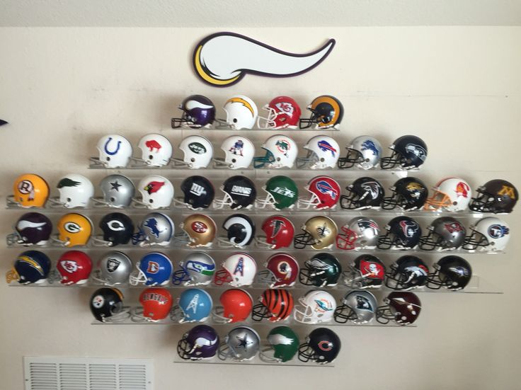 Man cave wall. These are the mini helmets--5 inches tall. Initial goal was four helmets--Vikings, Packers, Bears, Lions. Then things got out of control.   Football helmets display