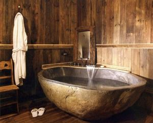 Reminds me of a traditional Japanese bath house. Lopa's note: example of the type of stone bath we will put in master