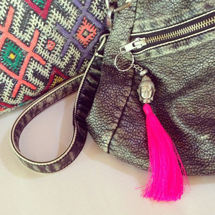 Our #buddha tassel keychains looking great as a bag charm too  Very protective and boho chic