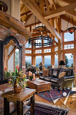 timber frame architectural stock photography, timber frame patio looking out to mountain view and setting sun, private residence, yellowstone club, montana, locati architects, design associates, schlauch bottcher construction