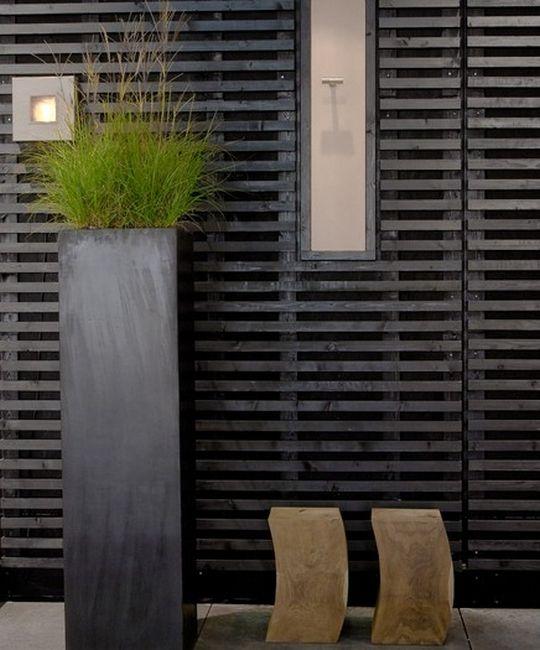 Horizontal black timber batten screen Pinned to Garden Design - Walls, Fences and Screens by Darin Bradbury.