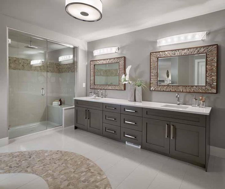 Master Ensuite, quartz counters, shower bench, custom tile detail, tile path. Kimberley Home's New Hampshire model in Jensen Lakes, St. Albert (Edmonton)  #bathroom #bathroomdesign #bathroomidea #freestandingtub #vanities #interiordesign #newhomedesign #homedesign #newhome #customhome #yegre #buildwithkimberley #kimberleyhomes
