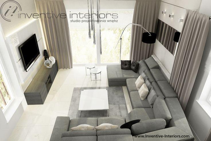 Projekt salonu Inventive Interiors - duży szary narożnik, biel i beż na ścianach w przytulnym eleganckim salonie
