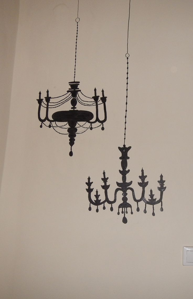 I drew these chandeliers freehand on my living room wall. First I sketched them with pencil and then I did the outline with permanent marker and then filled in the rest with black acrylic paint. E voila, was definitely cheaper than buying 2 wall decals :)