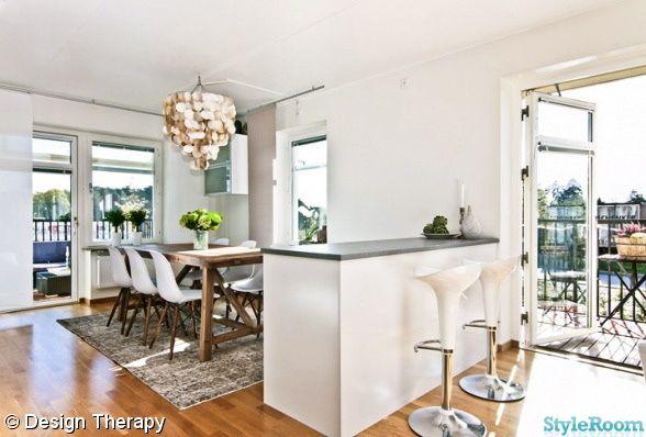 rustikt matbord,köksö,barstol,snäckskalslampa,eames stol,matplats