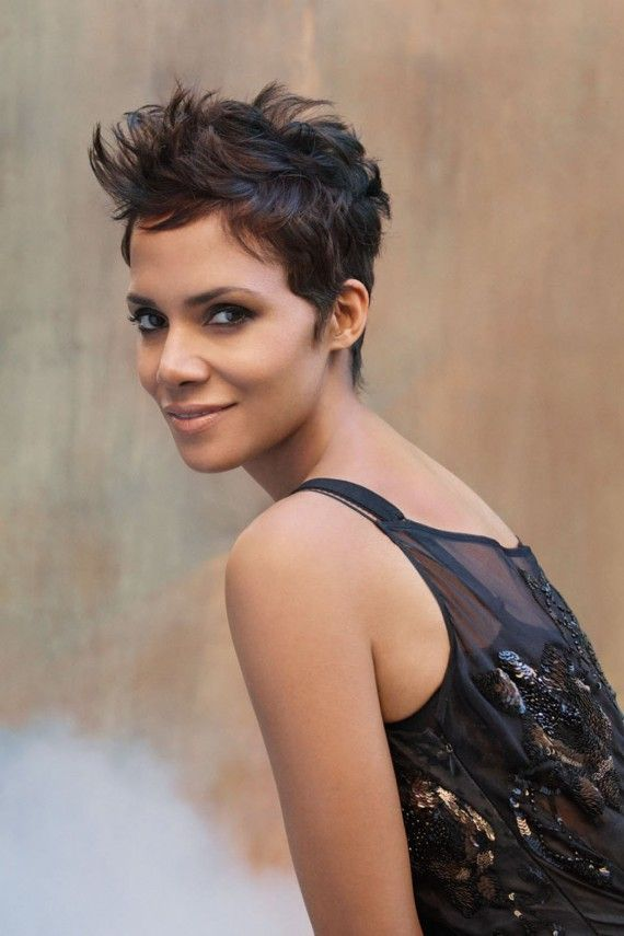 Halle Berry - Rub a large dollop of sculpting serum in your hands and work through hair. Continue brushing through with a one-inch ceramic round brush pulling hair forward toward the face. Let hair air-dry.