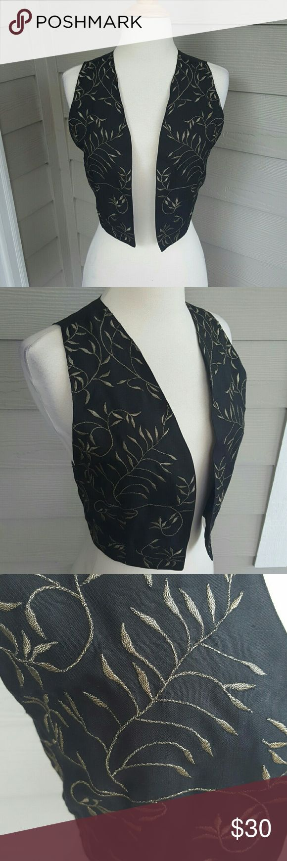 Must Go Vintage 100% Silk Vest Awesome silk black and gold best!  Ties in the back to make it adjustable!  Great floral gold detailing  100% silk and super soft!  Awesome piece  Thanks for shopping Vintage Jackets & Coats Vests