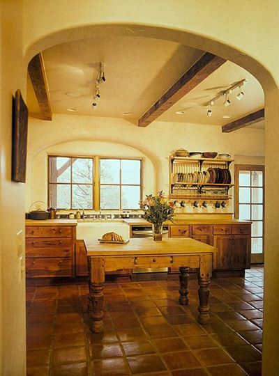 straw bale house kitchen. home and warm, but light and airy.