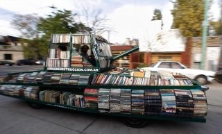 """'Raul Lemesoff, an Argentine art-car artist, has taken a 1979 Ford Falcon that used to belong to the Argentine armed forces and turned into a 'Weapon of Mass Instruction.Armed with 900 or so books Lemesoff travels the streets of Buenos Aires and beyond offering free books to all. He sees his 'Weapon of Mass Instruction' as a """"contribution to peace through literature."""": 1979 Ford, Artists, Ford Falcons, Free Book, Book Tanks, Raul Lemesoff, Weapons, Mass Instructions, Good Air"""