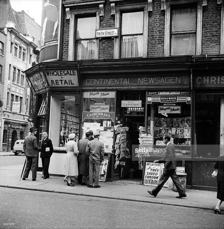 12th June 1956: A newsagent shop sells postcards and magazines to passers-by in Frith Street, Soho, London.