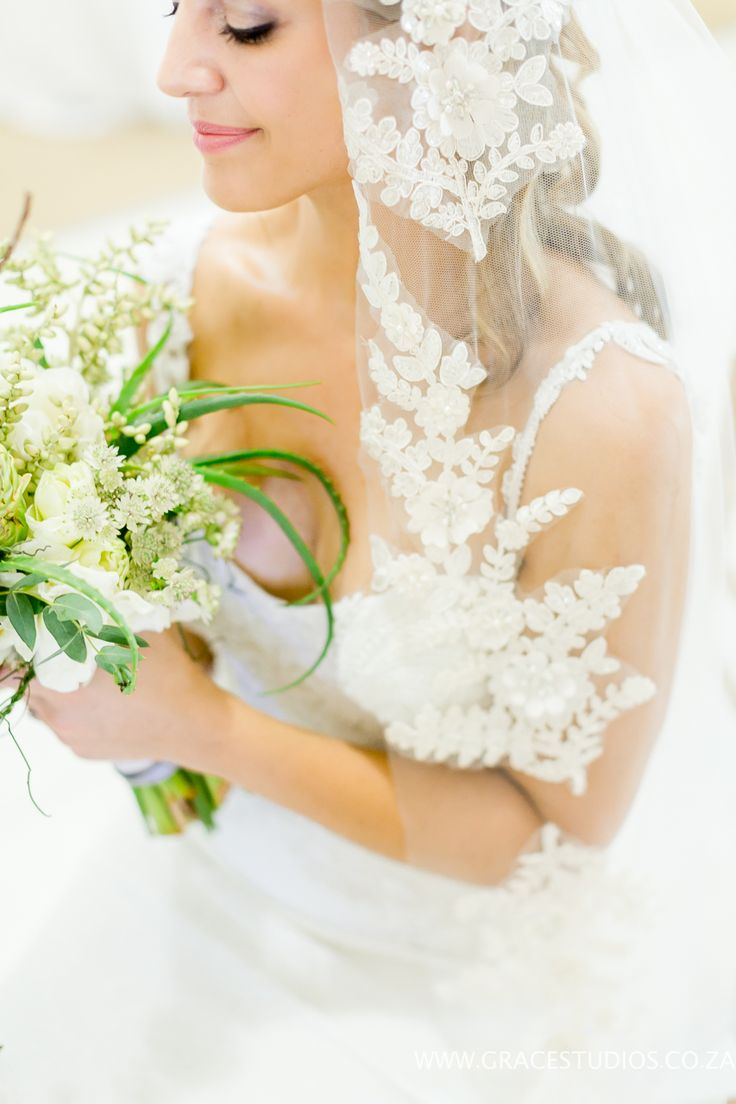 Lace Veil Kobus Dipinaar Wedding Dress beach wedding, Green beach Bouquet, luxury south african beach wedding, palm berries   http://www.absoluteperfection.co.za/#!CHANTELLE-AND-RJS-ROMANTIC-INTIMATE-BEACH-WEDDING/c1jar/57ad8b610cf2d58e4d0423e6