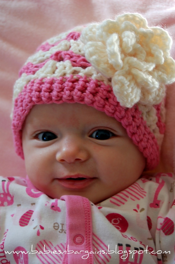 Cutest baby ever. Crocheted Hats with Flowers pattern