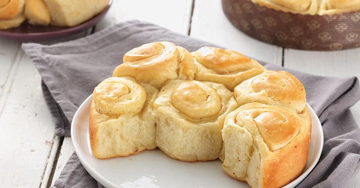 Soft spirals of buttery roll with mild sourdough tang.