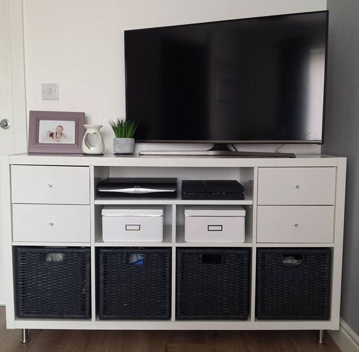 TV stand hack using the IKEA Kallax system, adding new shelves, capita legs and drawer inserts