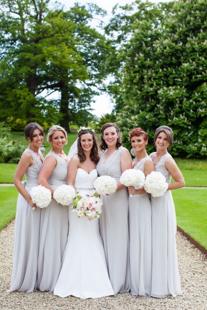 Beautiful bridesmaids and bride at Woburn sculpture gallery.  Hydrangea bouquets and blush and white bouquet for bride.