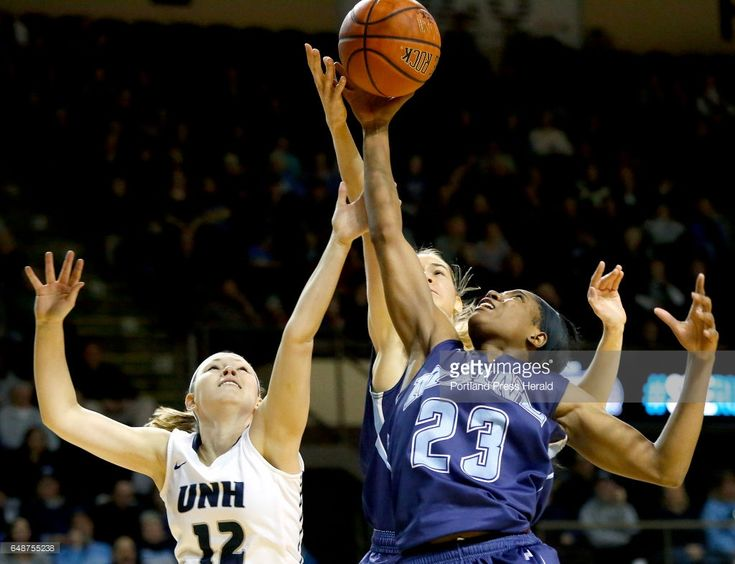 UNH's Peyton Booth battles with Anita Kelava and Tanesha Sutton of UMaine for control of the ball during second half action in the women's semifinal of the America East Tournament at the Cross Insurance Arena Sunday, March 5, 2017.
