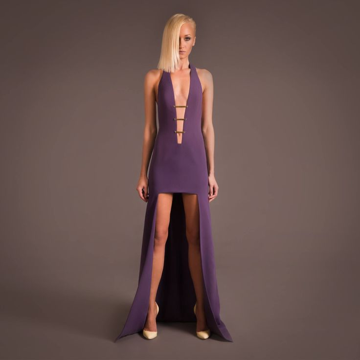 This is such a sexy, fun dress. Again, fantastic use of the high-low, and I love the plunging neckline with adjoining material. Stunning shade of purple too.