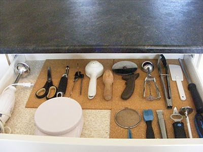 Dollar store corkboard tiles keep my most frequently used kitchen tools from slipping around inside the drawer