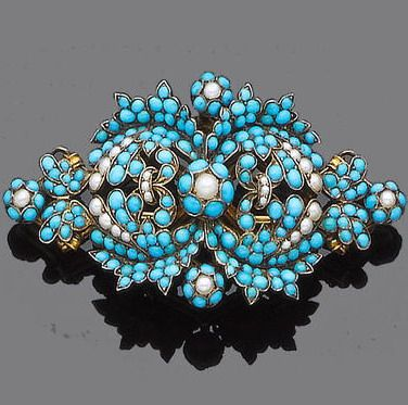 A turquoise and seed pearl brooch, single earring and pendant suite, circa 1830 The brooch of foliate openwork design, set throughout with cabochon turquoise, highlighted by seed pearls, together with an earring and pendant of matching design, pearls untested, pendant later converted, lengths: brooch 6.3cm, earring 6.0cm, pendant 6.9cm