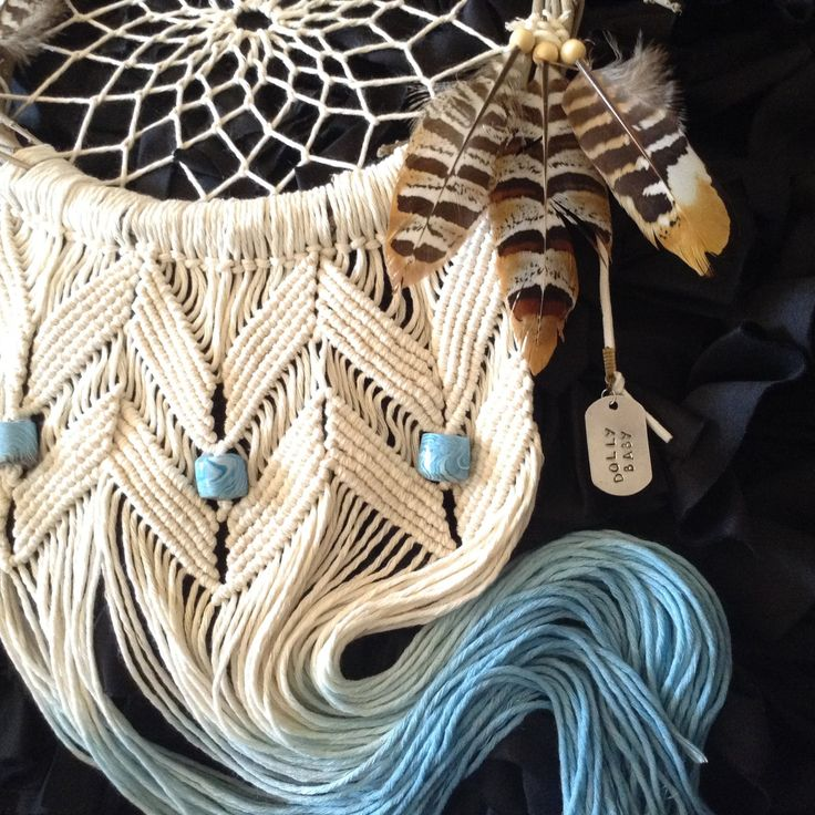 A personal favourite from my Etsy shop https://www.etsy.com/au/listing/477804062/dream-catcher-macrame-wreath-feather