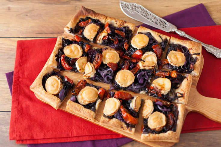 Carmelised Onion, Sundried Tomato & Goat's Cheese Tart – Crunchy pastry, oozy cheese and sweet, sweet onions – what better to offer guests than wedges of this amazing tart. Get the recipe here http://www.ilovecooking.ie/recipe/carmelised-onion-goats-cheese-tart/