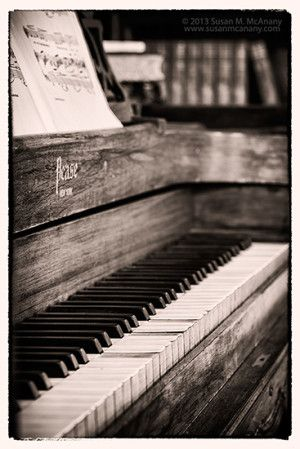 Long Ago Black and White Photo of Piano in library.