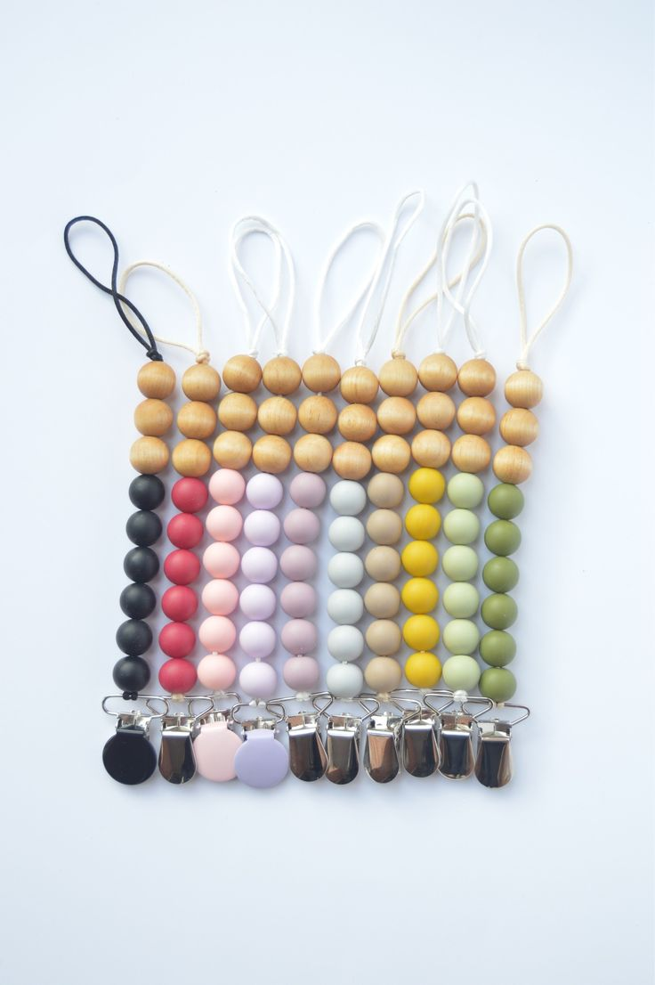Rainbow beaded soother clips.