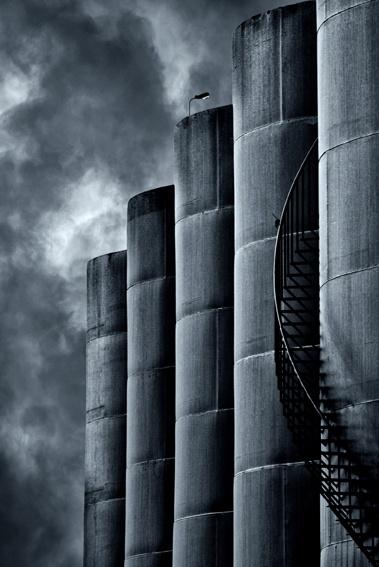 Stormy wheat silos soar towards the sky