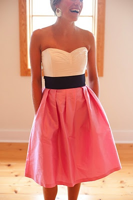Pretty dress for engagement party, rehersal dinner, or bridesmaids, strapless white sweatheart bodice, wide black band / belt, pleated soft red knee length skirt.  This would be pretty for bridesmaids with different color skirts.  Versatile dress for many occasions - yes, sometimes you really can wear them again!