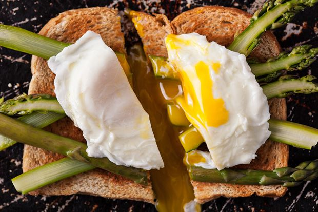 ... steamed asparagus halves on buttered wheat toast; top with a poached