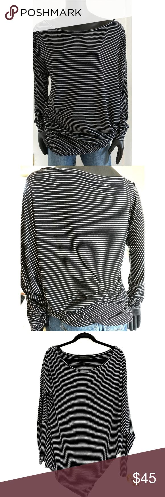 """BCBG MAXAZRIA Asymmetrical Striped Top, Large Striking asymmetrical striped pullover top, size large Measurements: neckline ~13"""" length ~26"""" from right shoulder to hem, 33"""" from left shoulder to longest hem Hem width ~19""""  The hem is asymmetric when on a hanger but it fits snugly around your waist or hips so that the top itself is asymmetric.  Great design!  Rayon/spandex blend is very comfortable.  Top is in excellent condition. BCBGMaxAzria Tops Blouses"""