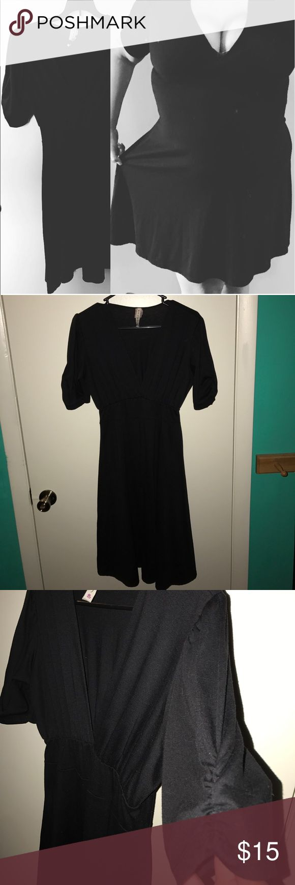 Sexy! Little black dress! So sexy. Only worn a hand ful of times. Fits like M/L depending on your boob size! Worn a few times as a hostess, made killer tips! Dresses Midi