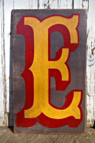 Painted fairground circus letters ... DIY this with our last name for the blank entry wall