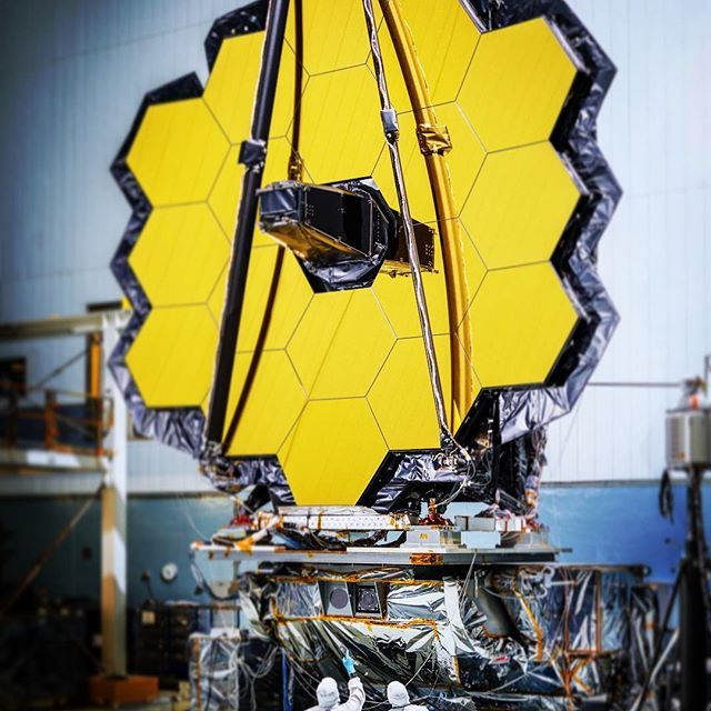 The primary mirror of NASA's James Webb Space Telescope consisting of 18 hexagonal mirrors looks like a giant puzzle piece standing in the massive clean room of NASA's Goddard Space Flight Center in Greenbelt, Maryland. Appropriately, combined with the rest of the observatory, the mirrors will help piece together puzzles scientists have been trying to solve throughout the cosmos.  Webb's primary mirror will collect light for the observatory in the scientific quest to better understand our…